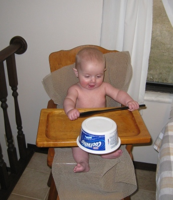 playing-in-high-chair-at-grandpas-house
