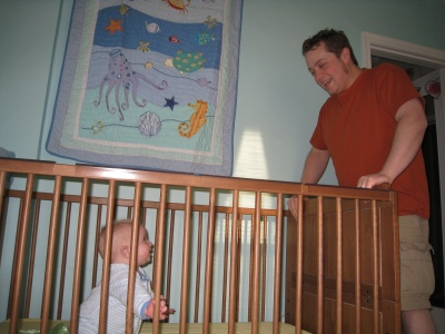 talking-to-daddy-in-crib