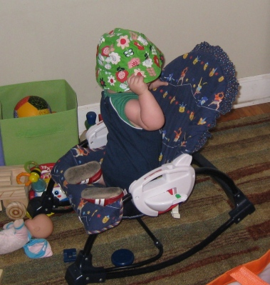 kivrin climbing in her chair and putting on her hat