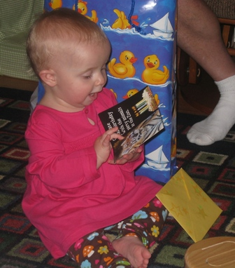 very very excited little girl with a picture of a tiger from grandpa