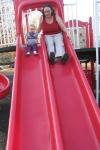 kivrin and mama on the slideracing